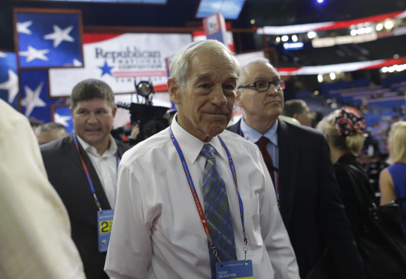 FILE - In this Aug. 28, 2012, file photo, Rep. Ron Paul, R-Texas, arrives on the floor at the Republican National Convention in Tampa, Fla. At least three Republican electors say they may not support their party's presidential ticket when the Electoral College meets in December to formally elect the new president. That prospect is escalating tensions within the GOP and adding a fresh layer of intrigue to the final weeks of the White House race.  (AP Photo/Charles Dharapak, File)