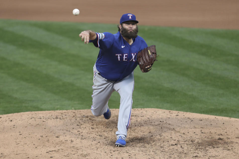 Texas Rangers pitcher Lance Lynn throws against the Oakland Athletics during the fifth inning of a baseball game in Oakland, Calif., Tuesday, Aug. 4, 2020. (AP Photo/Jed Jacobsohn)
