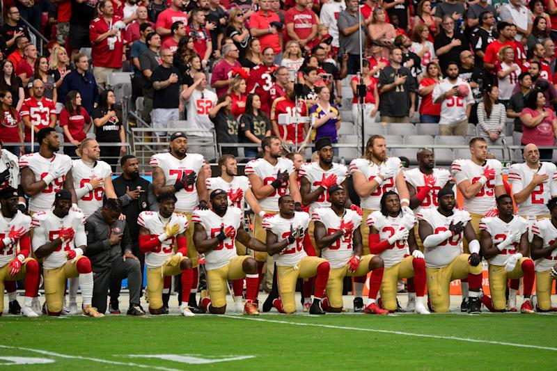 Members of the San Francisco 49ers take a knee in solidarity after Trump's criticism of the protest at an October game. (USA Today Sports / Reuters)