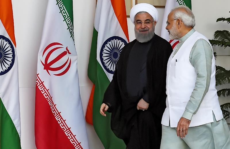 Iranian President Hassan Rouhani (L) and Indian Prime Minister Narendra Modi have agreed to step up efforts to help Afghanistan