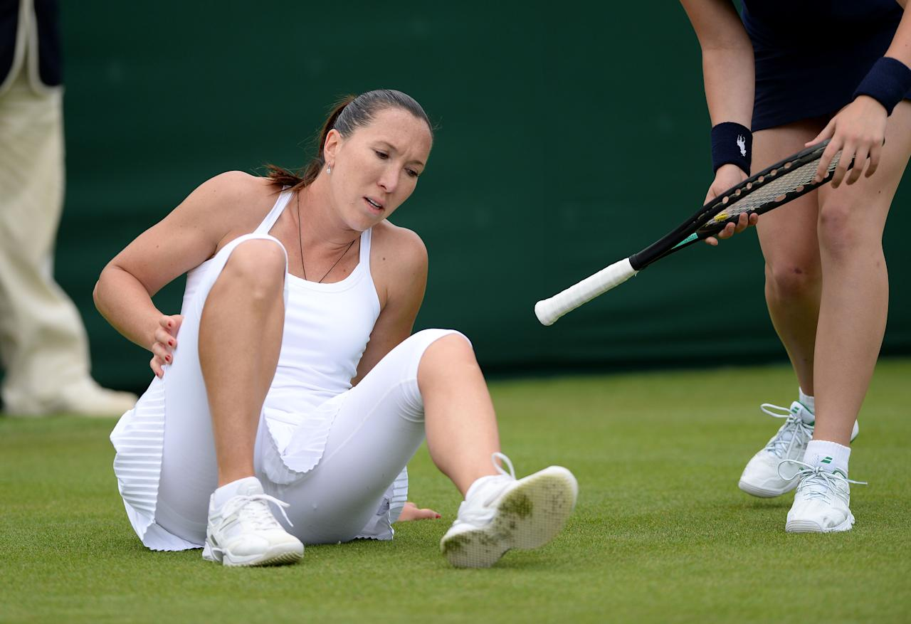 Serbia's Jelena Jankovic slips in her match against Great Britain's Johanna Konta during day one of the Wimbledon Championships at The All England Lawn Tennis and Croquet Club, Wimbledon.
