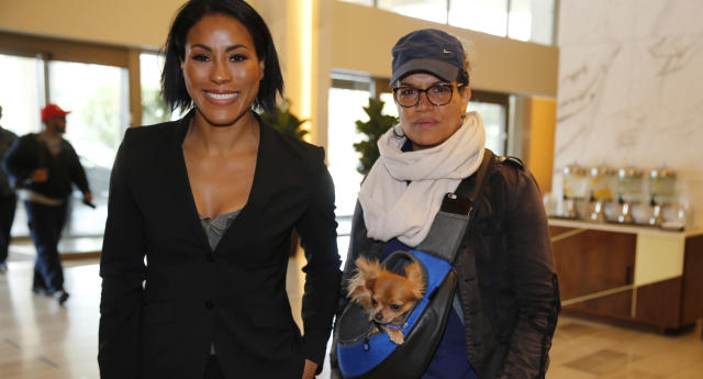 Cecilia Braekhus (L) arrives with her trainer, Lucia Rijker, at a news conference in Los Angeles on Wednesday, May 2, 2018. (AP)