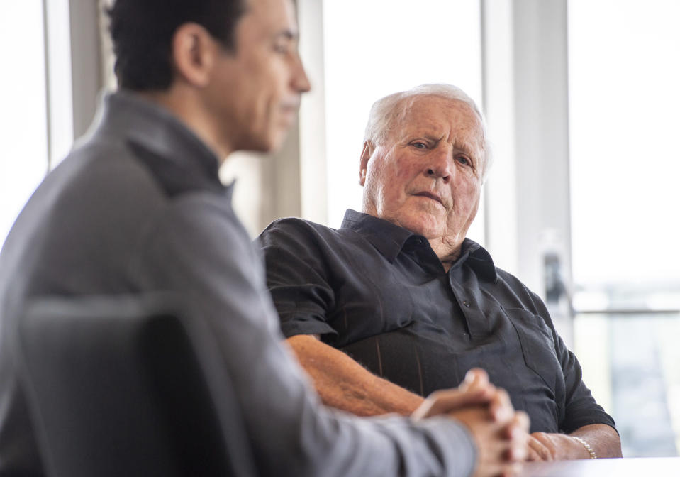 Four-time Indianapolis 500 auto race winner and NTT Indy Car series car owner A.J. Foyt listens while winner of this year's Indy 500, Helio Castroneves, speaks during a gathering with other four-time winners Al Unser (1970, 1971, 1978, 1987) and Rick Mears (1979, 1984, 1988, 1991) at the Indianapolis Motor Speedway in Indianapolis, Tuesday, July 20, 2021. Castroneves previously won the race in 2001, 2002, 2009. (AP Photo/Doug McSchooler)