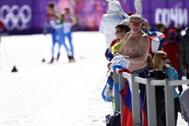 SOCHI, RUSSIA - FEBRUARY 13: A shirtless fan watches the Women's 10 km Classic during day six of the Sochi 2014 Winter Olympics at Laura Cross-country Ski & Biathlon Center on February 13, 2014 in Sochi, Russia. (Photo by Lars Baron/Getty Images)
