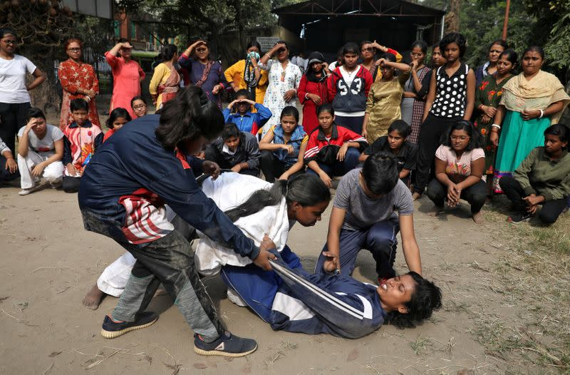 Girls practice a self-defense technique at a training camp in Kolkata