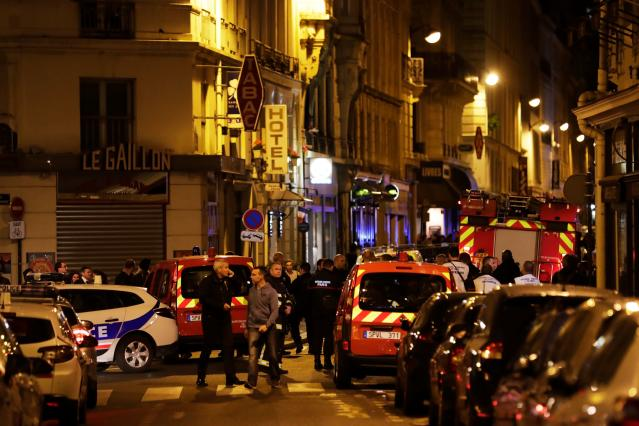 <p>Policemen and emergency service members stand in a blocked street in Paris centre after one person was killed and several injured by a man armed with a knife, who was shot dead by police in Paris on May 12, 2018. (Photo: Thomas Samson/AFP/Getty Images) </p>