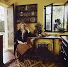 <p>Candice Bergen welcomes photographers into her rustic farmhouse kitchen in 1971. The actress left her doors and windows open, giving the room a Californian feel. </p>