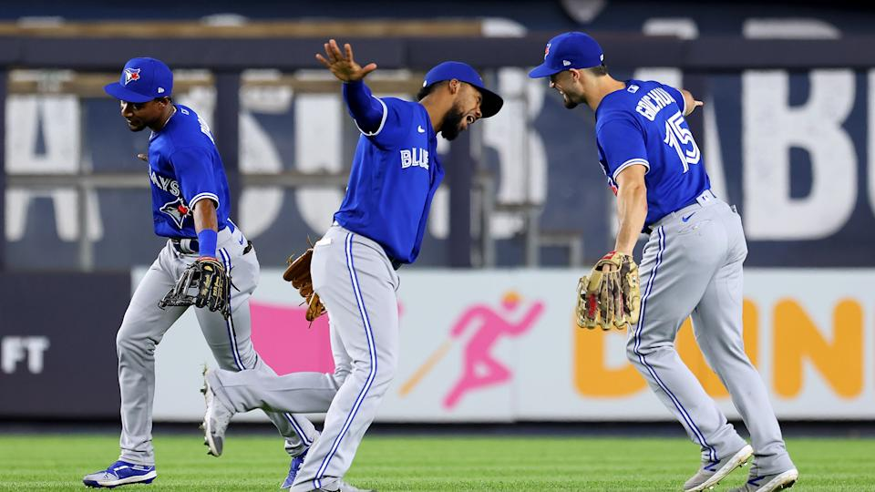 NEW YORK, NY - SEPTEMBER 07: (L-R) Outfielders Jarrod Dyson #1, Teoscar Hernandez #37 and Randal Grichuk #15 of the Toronto Blue Jays celebrate after defeating the New York Yankees 5-1 in a game at Yankee Stadium on September 7, 2021 in New York City. (Photo by Rich Schultz/Getty Images)