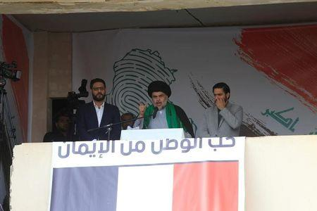 FILE PHOTO - Iraqi Shi'ite cleric Moqtada al-Sadr speaks during a protest against corruption and informs his followers about his will at Tahrir Square in Baghdad