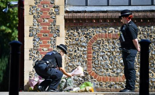 Flowers have been left at the entrance to Forbury Gardens park, where the attack took place