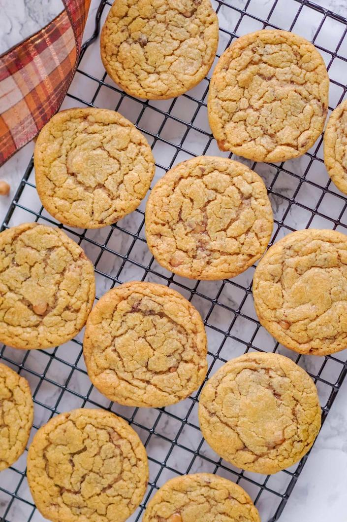 """<p>Think of these cookies as a pumpkin-inspired Heath bar. There are crunchy toffee pieces and rich pumpkin in every bite. </p><p><strong>Get the recipe at <a href=""""https://www.thechunkychef.com/toffee-crunch-pumpkin-cookies/"""" rel=""""nofollow noopener"""" target=""""_blank"""" data-ylk=""""slk:The Chunky Chef"""" class=""""link rapid-noclick-resp"""">The Chunky Chef</a>.</strong><br></p><p><a class=""""link rapid-noclick-resp"""" href=""""https://go.redirectingat.com?id=74968X1596630&url=https%3A%2F%2Fwww.walmart.com%2Fsearch%3Fq%3Dbaking%2Bmat&sref=https%3A%2F%2Fwww.thepioneerwoman.com%2Ffood-cooking%2Fmeals-menus%2Fg36875717%2Ffall-cookies%2F"""" rel=""""nofollow noopener"""" target=""""_blank"""" data-ylk=""""slk:SHOP BAKING MATS"""">SHOP BAKING MATS </a></p>"""