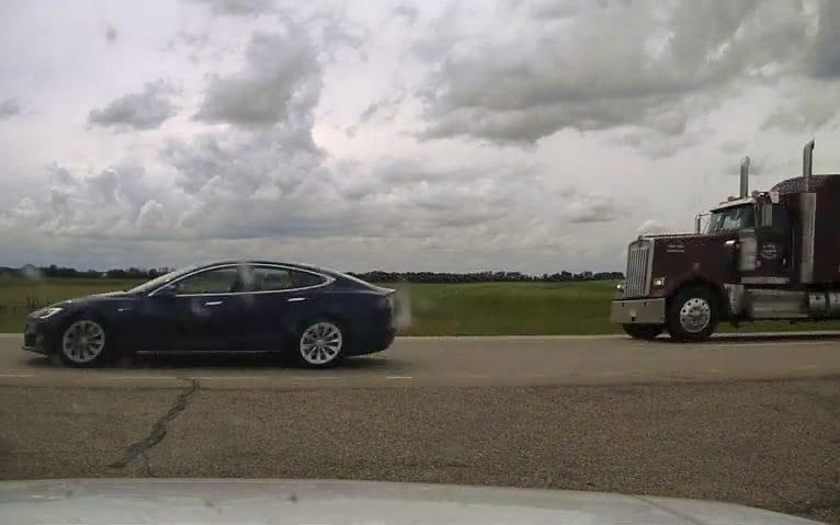 The Tesla car with its driver and passenger asleep inside - RCMP