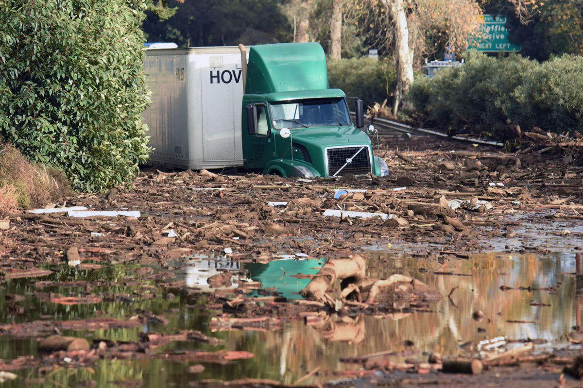 <p>A truck is seen stranded in the aftermath of the mudslide after it hit California on Monday (AP) </p>
