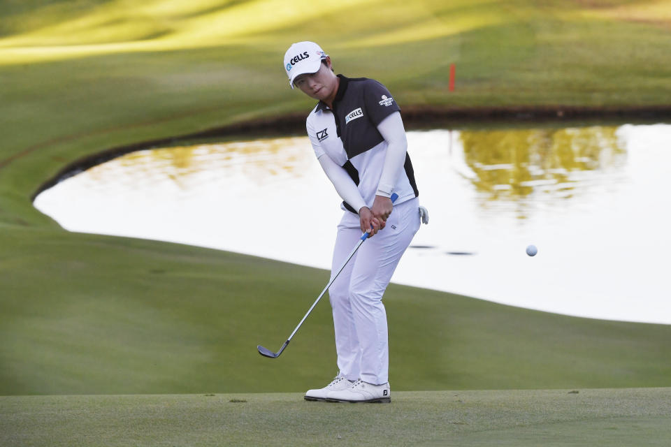 Eun-Hee Ji, of South Korea, hits onto the 18th green during the second round of the LPGA Walmart NW Arkansas Championship golf tournament, Saturday, Sept. 25, 2021, in Rogers, Ark. (AP Photo/Michael Woods)