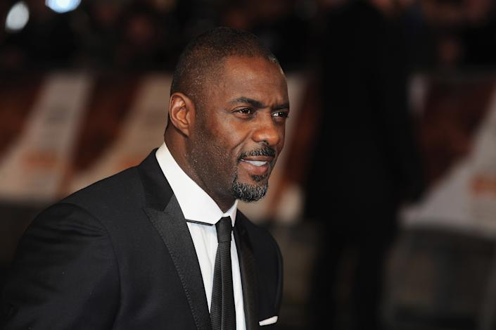 """LONDON, ENGLAND - DECEMBER 05:  Idris Elba attends the Royal film performance of """"Mandela: Long Walk To Freedom"""" at Odeon Leicester Square on December 5, 2013 in London, United Kingdom.  (Photo by Ferdaus Shamim/WireImage)"""