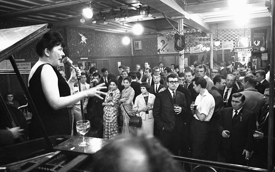 Cabaret singer performing in a East End of London pub on a Saturday night, 6th July 1963. (Photo by Brian Randle/Mirrorpix/Getty Images) - Getty