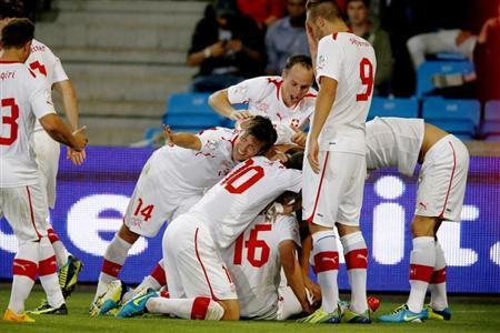 Switzerland's players celebrate after scoring their second goal against Norway during their 2014 World Cup qualifying soccer match in Oslo