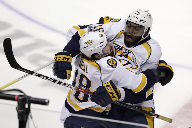 <p>Nashville Predators James Neal, left, celebrates after scoring against the Anaheim Ducks off an assist by defenseman P.K. Subban, right, in overtime of Game 1 in the NHL hockey Stanley Cup Western Conference finals, May 12, 2017, in Anaheim, Calif. The Predators won 3-2. (Photo: Chris Carlson/AP) </p>