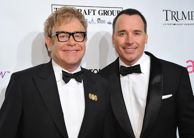 """FILE - In this Oct. 18, 2010 file photo, Sir Elton John, left, and David Furnish attend the Ninth Annual Elton John AIDS Foundation benefit 'An Enduring Vision' at Cipriani Wall Street in New York. Elton John and David Furnish say they have become parents for a second time. The couple say they are """"overwhelmed with happiness"""" at the birth of Elijah Joseph Daniel Furnish-John. John's spokeswoman Fran Curtis confirmed an announcement on the singer's website that the baby was born Friday Jan. 11, 2013 in Los Angeles to a surrogate mother, weighing 8 pounds, 4 ounces (3.7 kilograms). (AP Photo/Evan Agostini, File)"""