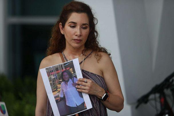 PHOTO: Luz Marina holds a picture of her aunt, Marina Azen, who she said is missing after the partial collapse of the 12-story Champlain Towers South condo tower that she was in on June 24, 2021 in Surfside, Fla. (Joe Raedle/Getty Images)