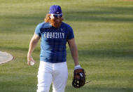 Los Angeles Dodgers' Justin Turner smiles during a workout, Tuesday, Sept. 29, 2020, at Dodger Stadium in Los Angeles, ahead of Wednesday's Game 1 of a National League wild-card baseball series against the Milwaukee Brewers. (AP Photo/Chris Pizzello)