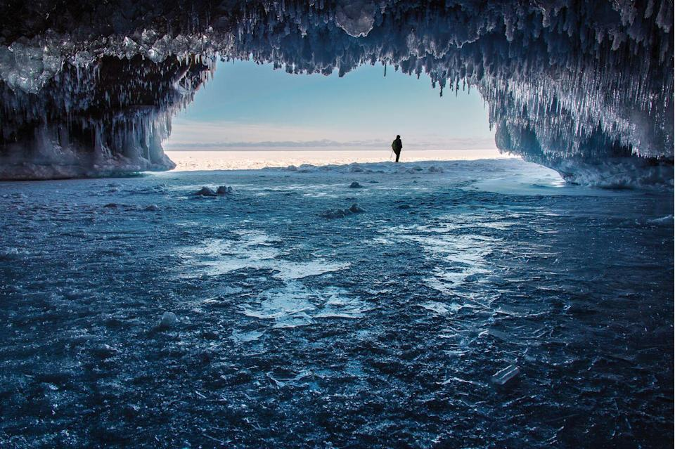 """<p>Who knew these fantastical ice caves could be found right in Wisconsin's Apostle Islands? Although the ice doesn't grow strong enough for sightseers to hike out to them every year (this year, for example, hiking is prohibited), the formations that do grow during the coldest years are impressive. Make a trip out to the <a href=""""https://www.nps.gov/apis/mainland-caves-winter.htm"""" rel=""""nofollow noopener"""" target=""""_blank"""" data-ylk=""""slk:Mainland Unit of the Apostle Islands National Lakeshore"""" class=""""link rapid-noclick-resp"""">Mainland Unit of the Apostle Islands National Lakeshore</a> after an especially chilly winter.</p>"""