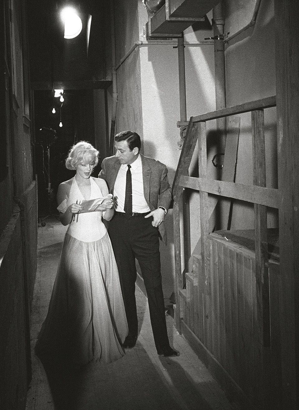 """<p>""""On the set, you didn't need to hear rumours of a physical attraction between Marilyn and Montand, because you could feel the heat they generated."""" </p>"""