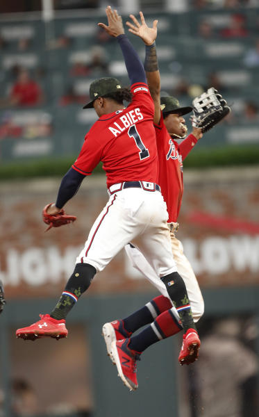 Atlanta Braves' Ozzie Albies (1) and Ronald Acuna Jr. celebrate after the Braves defeated the Milwaukee Brewers 12-8 in a baseball game Friday, May 17, 2019, in Atlanta. (AP Photo/John Bazemore)