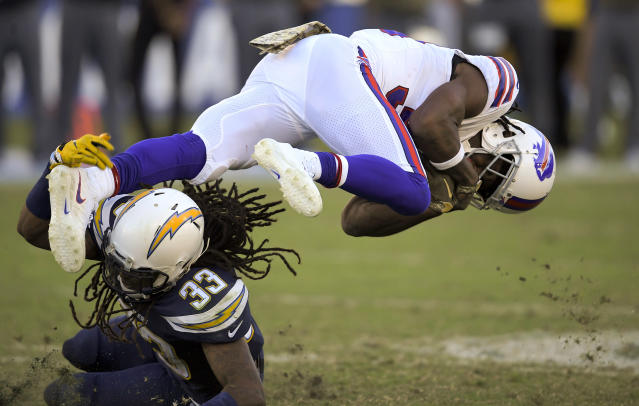 <p>Buffalo Bills running back Travaris Cadet, right, is tackled by Los Angeles Chargers free safety Tre Boston during the second half of an NFL football game Sunday, Nov. 19, 2017, in Carson, Calif. (AP Photo/Mark J. Terrill) </p>