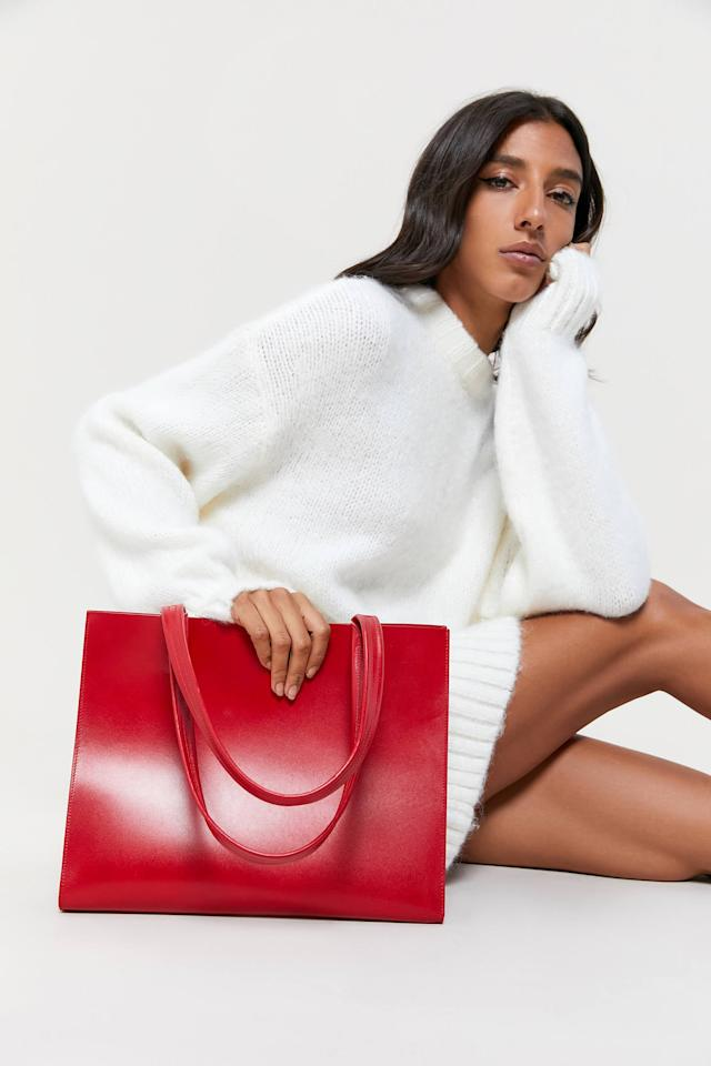 """<p>Add a pop of color to your wardrobe with this <a href=""""https://www.popsugar.com/buy/Minor-History-News-Tote-Bag-543307?p_name=Minor%20History%20News%20Tote%20Bag&retailer=urbanoutfitters.com&pid=543307&price=188&evar1=fab%3Aus&evar9=47257027&evar98=https%3A%2F%2Fwww.popsugar.com%2Ffashion%2Fphoto-gallery%2F47257027%2Fimage%2F47257880%2FMinor-History-News-Tote-Bag&list1=shopping%2Caccessories%2Cbags%2Cworkwear%2Chandbags%2Cfashion%20shopping&prop13=api&pdata=1"""" rel=""""nofollow"""" data-shoppable-link=""""1"""" target=""""_blank"""" class=""""ga-track"""" data-ga-category=""""Related"""" data-ga-label=""""https://www.urbanoutfitters.com/shop/minor-history-news-tote-bag2?category=bags-wallets-for-women&amp;color=060&amp;type=REGULAR"""" data-ga-action=""""In-Line Links"""">Minor History News Tote Bag</a> ($188).</p>"""