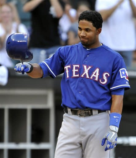 Texas Rangers' Elvis Andrus flips his helmet after striking out looking during the second inning of a baseball game against the Chicago White Sox, Wednesday, July 4, 2012, in Chicago. The White Sox won 5-4 in 10 innings. (AP Photo/Brian Kersey)