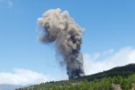 A plume of smoke rises followng the eruption of a volcano in Spain