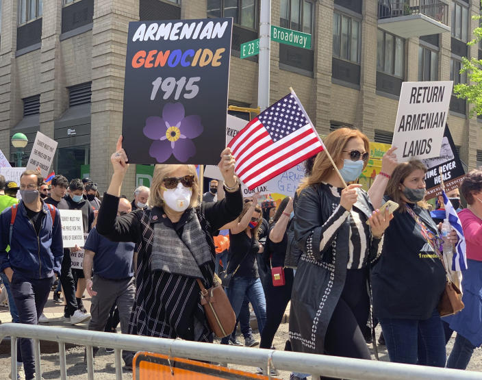"""Demonstrators march in a rally protesting against Armenian genocide on 23rd Street, Saturday, April 24, 2021, in New York. The United States is formally recognizing that the systematic killing and deportation of hundreds of thousands of Armenians by Ottoman Empire forces in the early 20th century was """"genocide"""" as President Joe Biden used that precise word that the White House has avoided for decades for fear of alienating ally Turkey. (AP Photo/Pamela Hassell)"""