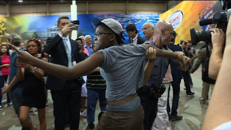 Image from video shows police removing a protester from a rally with Republican presidential candidate Donald Trump at the Expo Hall of the Richmond International Raceway on October 14, 2015 in Richmond, Virginia