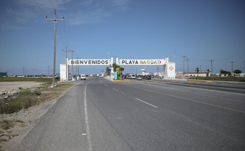 This Aug. 3, 2019 photo shows an entrance welcoming travelers to Playa Bagdad near the border city of Matamoros, Mexico. DEA Special Agent Sammy Parks said Playa Bagdad is a center for loading and unloading drugs bound for the U.S. market. It is a short, easy route without much law enforcement. (AP Photo/Emilio Espejel)