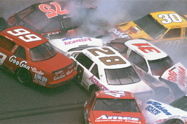 FILE - In this Feb. 17, 1990, file photo, race cars crash during the Goody's 300 auto race in Daytona Beach, Fla. (AP Photo/David Graham, File)