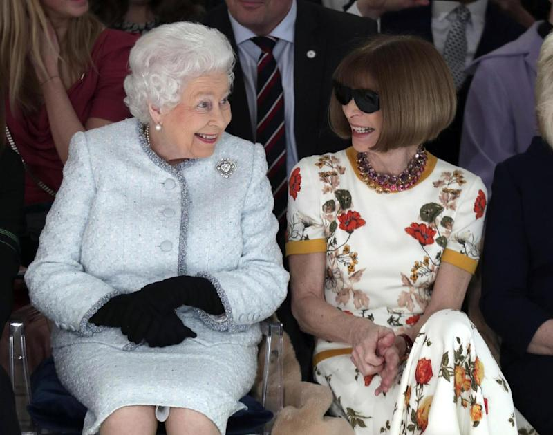 The Queen sat next to Anna Wintour at London Fashion Week (AP)