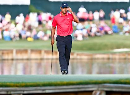 Tiger Woods tips his hat to the crowd on the 17th green. (USA Today)