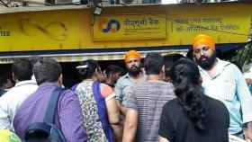 PMC Bank depositors detained after protest