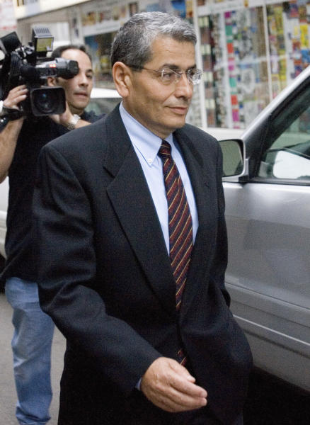 FILE - In this May 1, 2008 file photo, Ali Ata leaves federal court in Chicago. On Tuesday, July 17, 2012, a federal judge is set to sentence Ata, the former executive director of the Illinois Finance Authority who landed his job after donating $50,000 to then-Illinois Gov. Rod Blagojevich's campaign. The sentencing in the 'play-to-play' scheme comes two years after Ata testified at Blagojevich's first corruption trial. (AP Photo/Brian Kersey, File)