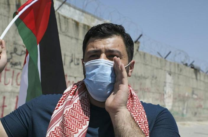 A Palestinian man takes part in a demonstration in the West Bank on May 16 (AFP Photo/JAAFAR ASHTIYEH)