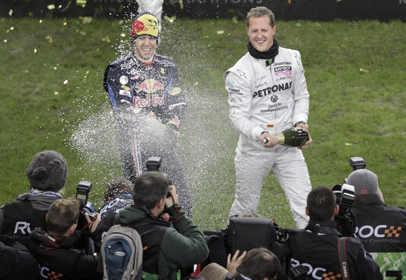 Mercedes F1 driver Michael Schumacher, right, and Red Bull driver Sebastian Vettel celebrate after winning the nations cup at the Race of Champions, in Duesseldorf, Germany, Saturday Nov. 27,2010. (AP Photo/Frank Augstein)