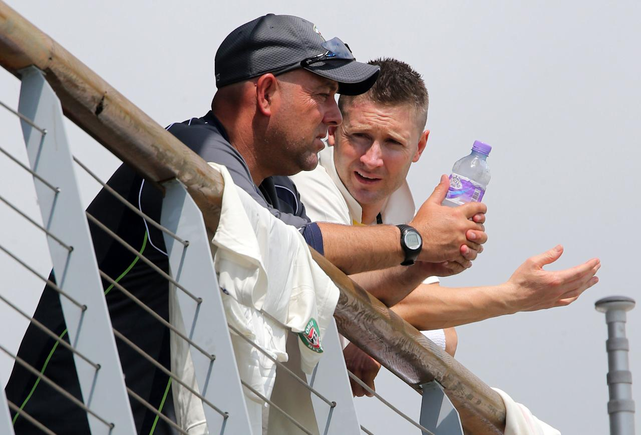 Australia captain Michael Clarke (right) speaks with coach Darren Lehmann during day three of the International Warm up match at New Road against Worcestershire at Worcester.