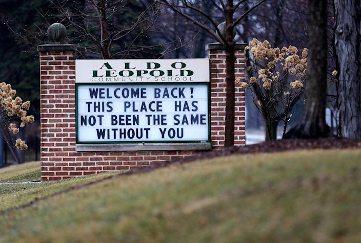 The sign outside Aldo Leopold Community School in Green Bay, Wis., welcomes back students upon their return to in-person classes in March 2021 after almost a year of virtual learning due to the coronavirus pandemic.