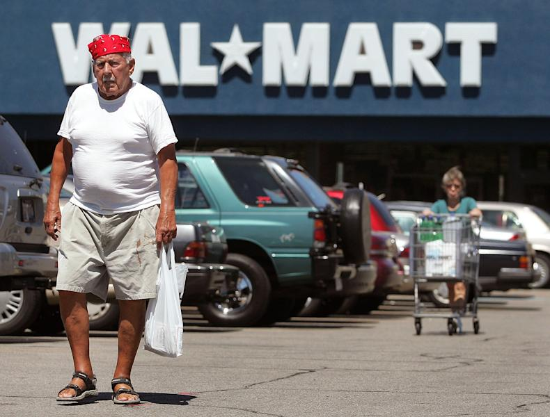 Two shoppers walk in the parking lot outside a Wal-Mart store on August 15, 2006 in Mount Prospect, Illinois (AFP Photo/Tim Boyle)