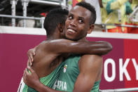 Selemon Barega, of Ethiopia, left, celebrates with compatriot Berihu Aregawi after winning the men's 10,000-meters final at the 2020 Summer Olympics, Friday, July 30, 2021, in Tokyo. (AP Photo/Matthias Schrader,Pool)
