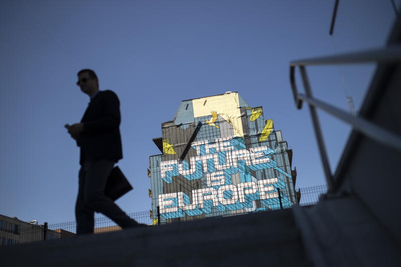 A man walks past a pro Europe street art painting in the European quarter in Brussels, Tuesday, July 23, 2019. Brexit champion Boris Johnson won the contest to lead Britain's governing Conservative Party on Tuesday and will become the country's next prime minister, tasked with fulfilling his promise to lead the U.K. out of the European Union. (AP Photo/Francisco Seco)