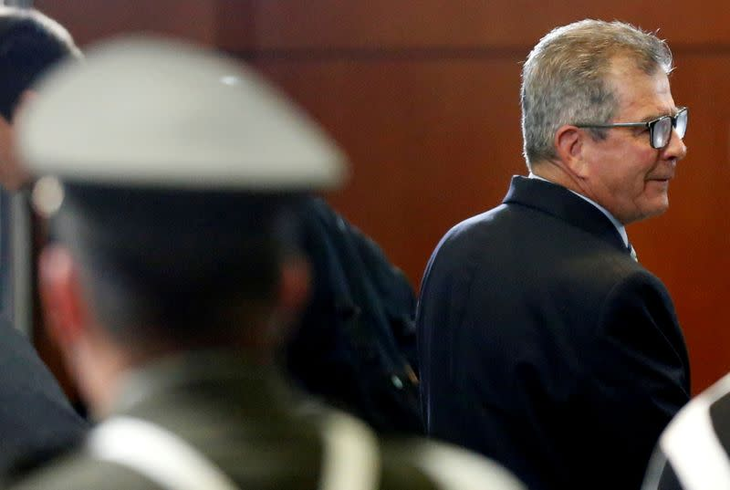 FILE PHOTO: Former commander of the Colombian Army General Montoya attends a hearing at the Special Jurisdiction for Peace court in Bogota