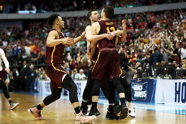 The Loyola Chicago Ramblers celebrate with junior guard Clayton Custer after his game-winning shot against Tennessee in the NCAA tournament. (Getty)