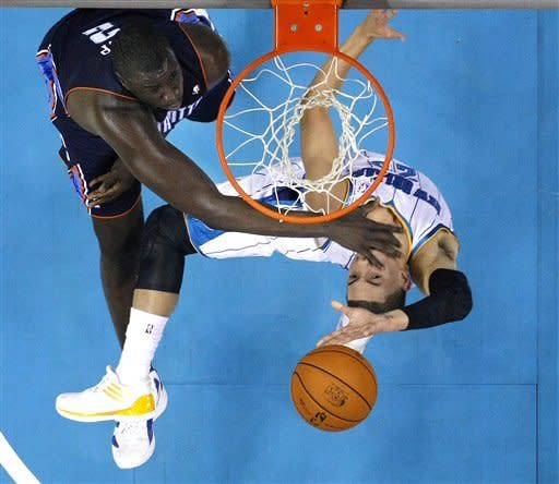 New Orleans Hornets guard Austin Rivers (25) goes to the basket against Charlotte Bobcats center DeSagana Diop (2) during the first half of an NBA preseason basketball game in New Orleans, Tuesday, Oct. 9, 2012. (AP Photo/Gerald Herbert)